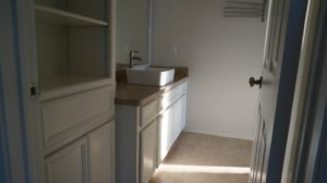 bathroom has storage along with giant walk in closet