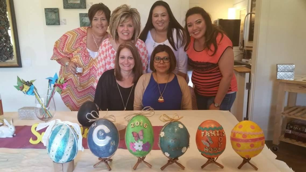 group of women and the ostrich eggs they decorated